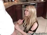 Real amateur blonde teen gives a handjob in the kitchen